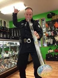 cop hitting a bong