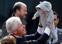 Pres kissing baby three