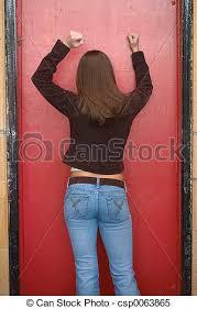 woman banging on door